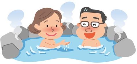 半身浴する夫婦